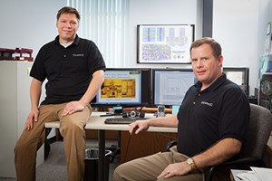 Matt Francis (left) and Jim Holmes of Ozark Integrated Circuits, pose in their office at the Arkansas Research and Technology Park in Fayetteville. Photo by Russell Cothren, University of Arkansas